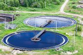 foto of groundwater  - Aerial view of water treatment plant with round settlers