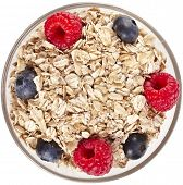 picture of oats  - oat flake in a bowl with fresh berries surface top view - JPG