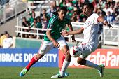PASADENA, CA - JULY 7: Carlos Pena #6 of Mexico and Anibal Godoy #20 of Panama during the 2013 CONCA