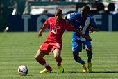 PASADENA, CA - JULY 7: Simeon Jackson #10 of Canada & Daniel Herelle #4 of Martinique during the 201