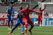 PASADENA, CA - JULY 7: Jean Sylvain Babin #22 of Martinique & Marcus Haber #11 of Canada during the