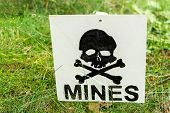 stock photo of landmines  - warning sign warning landmines in this field - JPG