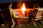 stock photo of lawn chair  - Couple by the bonfire - JPG