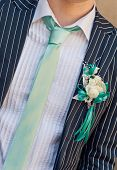 stock photo of boutonniere  - wedding boutonniere on suit of groom - JPG