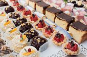 stock photo of buffet catering  - assortment of sweets - JPG