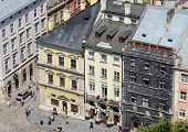 Tourists visiting medieval market square with famous landmark - Black House,Lviv,Ukraine