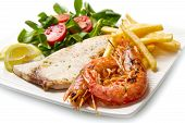stock photo of swordfish  - white dish with grilled swordfish and prawn - JPG