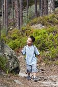 Child walking in forest