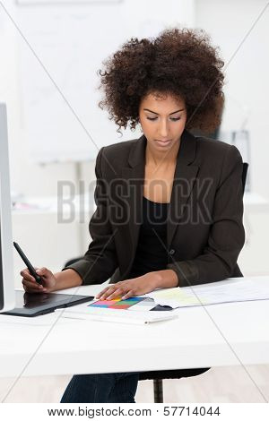 Businesswoman Hard At Work At Her Desk