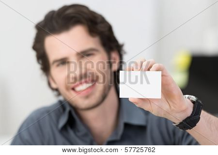 Handsome Businessman Holding Up His Card