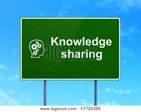 Education concept: Knowledge Sharing and Head With Gears on road sign background