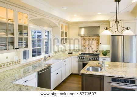 Luxury Kitchen with beige granite counter tops and island