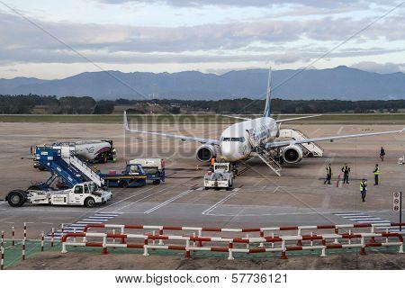 People Boarding In A Plane.