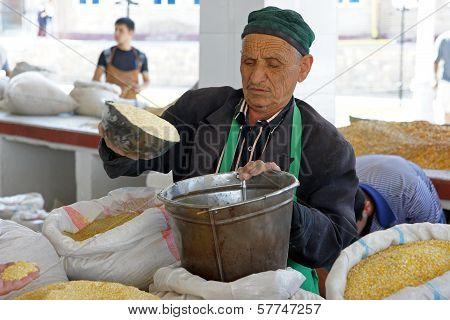 Old man trading on a food market, Samarkand, Uzbekistan