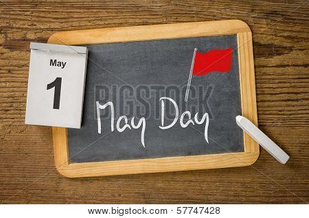 May Day May 1 written on a blackboard