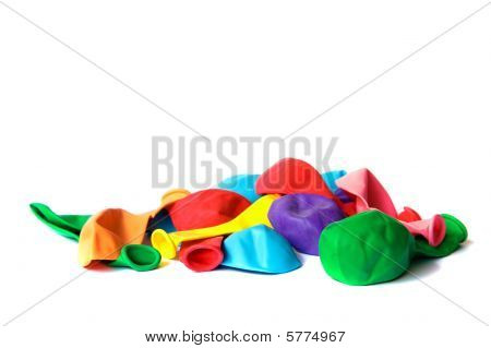 Ready For Party! Many Deflated Colored Balloons Isolated On White