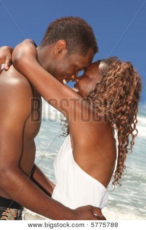 African American Couple In Love On The Beach