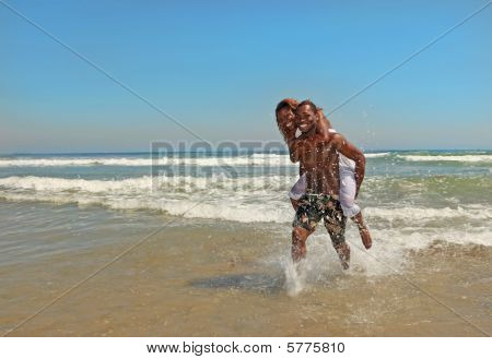 Happy African American Couple At The Beach