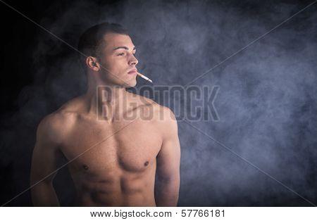 Muscular Shirtless Young Man Smoking Sigarette