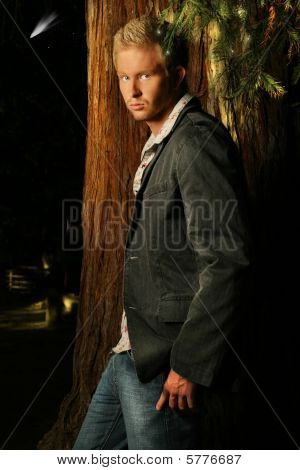 Outdoor night portrait of a young male fashion model