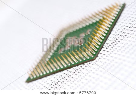 A Tilted View Of A Computer Cpu Chip On Binary Code
