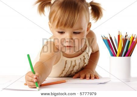 Cute Child Draw With Crayons