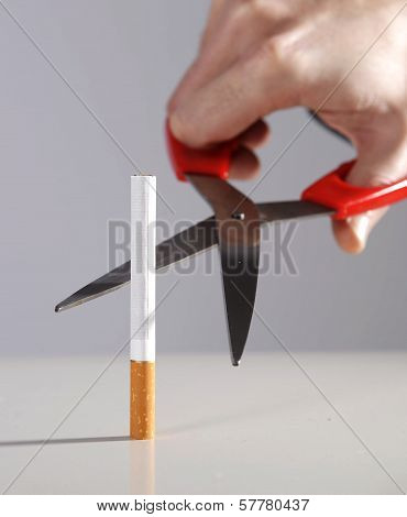 Health concept quit smoking resolution cutting a cigarette with scissors