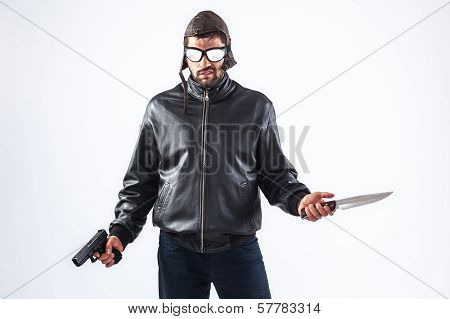Violent Young Man Holding A Gun And A Knife