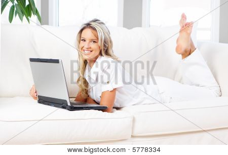 Young Beautiful Woman Working With Laptop  In The New  Comfortable Apartment