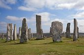 picture of megaliths  - The standing stone circle at Callanish Isle of Lewis Outer Hebrides Scotland . Cross-shaped setting of standing stones erected around 2000BC one of the most spectacular megalithic monuments in Scotland. - JPG