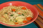 stock photo of parsnips  - Bowl of chicken noodle soup with carrots parsnips and parsley