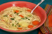image of parsnips  - Bowl of chicken noodle soup with carrots parsnips and parsley