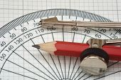 picture of protractor  - plastic protractor and compass on graph paper - JPG
