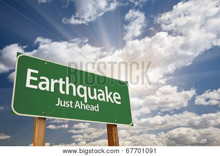 Earthquake Green Road Sign with Dramatic Clouds and Sky.