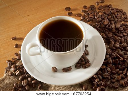 A Cup Of Coffee On A Wooden Table Top View