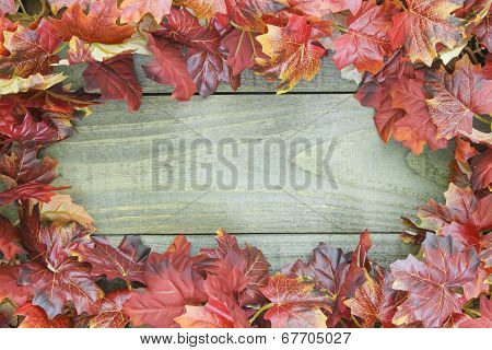 Autumn leaves border rustic wooden background