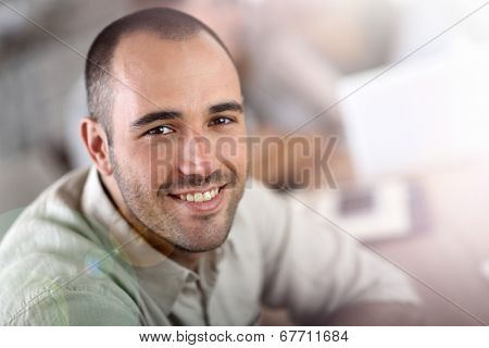 Young man attending business school project