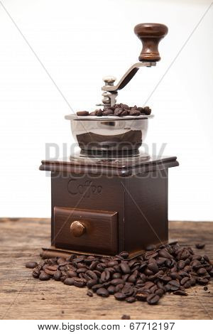 Isolated Coffee Bean Grinder Next To Fresh Coffe Bean