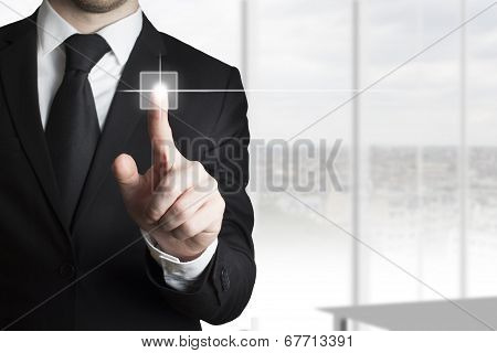 businessman pressing touchscreen button office