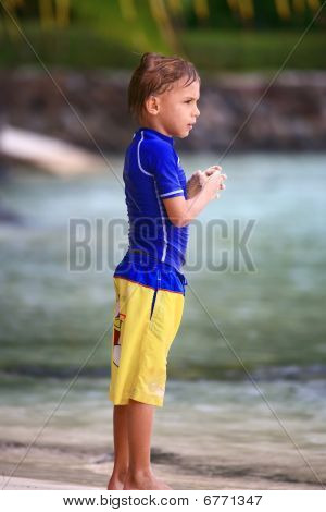Boy Standing On The Beach