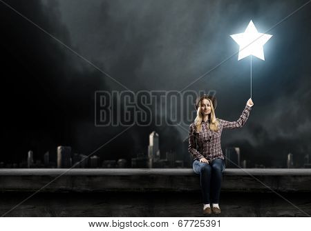Young woman in casual with balloon shaped like star