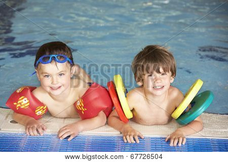 Young boys in swimming pool