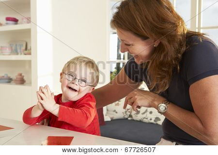 Downs Syndrome boy having speech therapy
