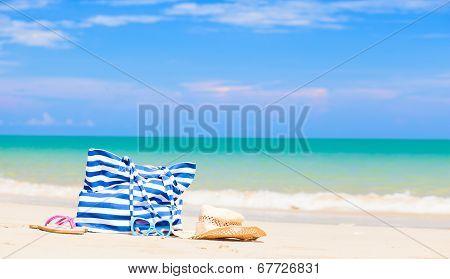 beach bag, sunglasses and flip flops at tropical beach. Thailand, Khaol Lak
