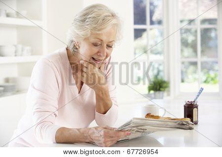 Retired woman eating breakfast