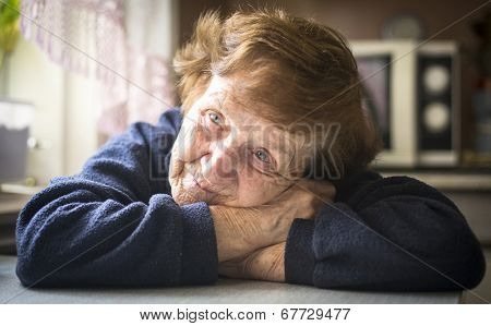 Portrait of old woman in her home.
