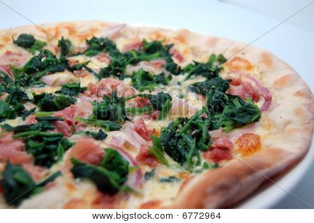Ham, spinach and onion pizza - angled shot