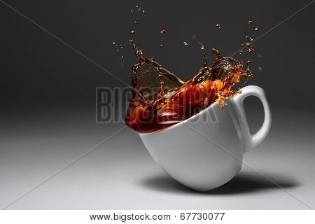 Cup Of Coffee Or Tea Fell Illuminated Surface. Spilled Drink