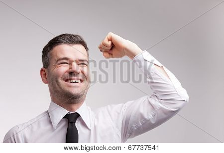 Happy Man Exulting Raising His Arm