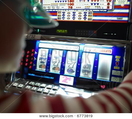 Young Woman Playing Slot Machine